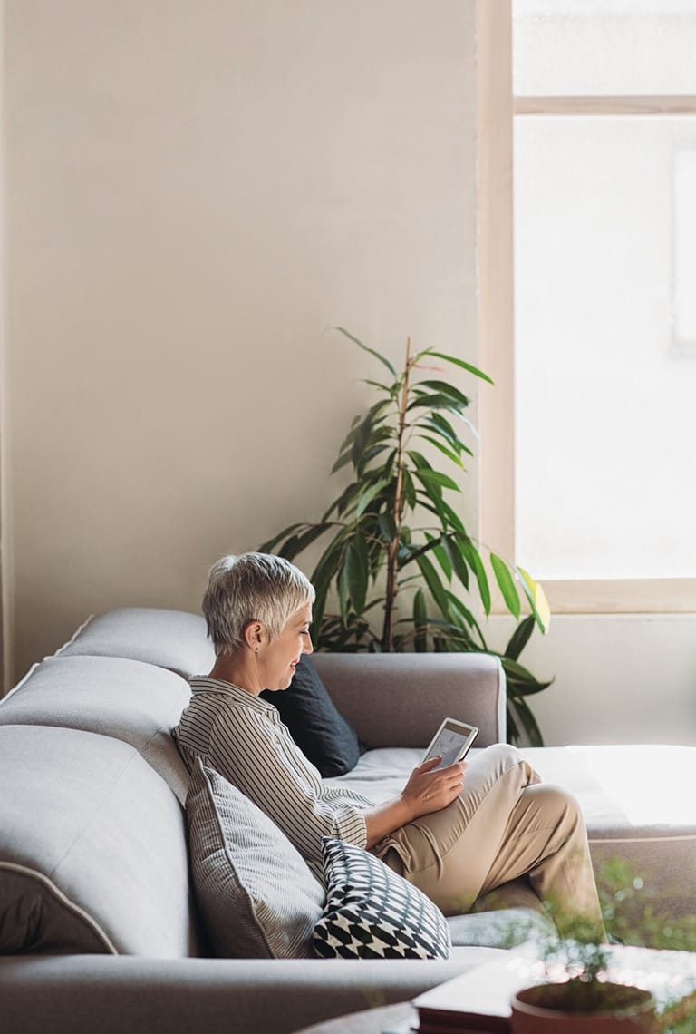 Lady reading tablet in lounge